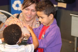 Clayton families enjoying bubble tables at Children's Museum of Denver's Family Night