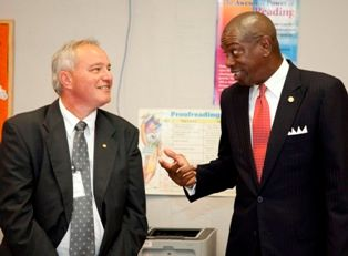 Keith Holloway discusses the event with Rep. Oliver Robinson at a reception after the reading.