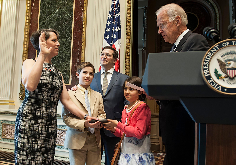 Suzi LeVine being sworn in by Vice President Joe Biden.