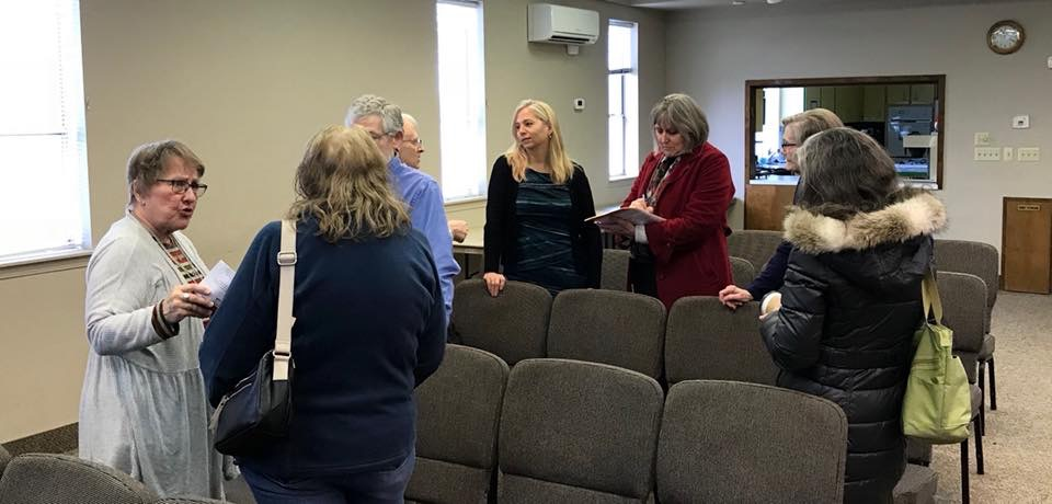 Making connections after a community presentation at West Side Church