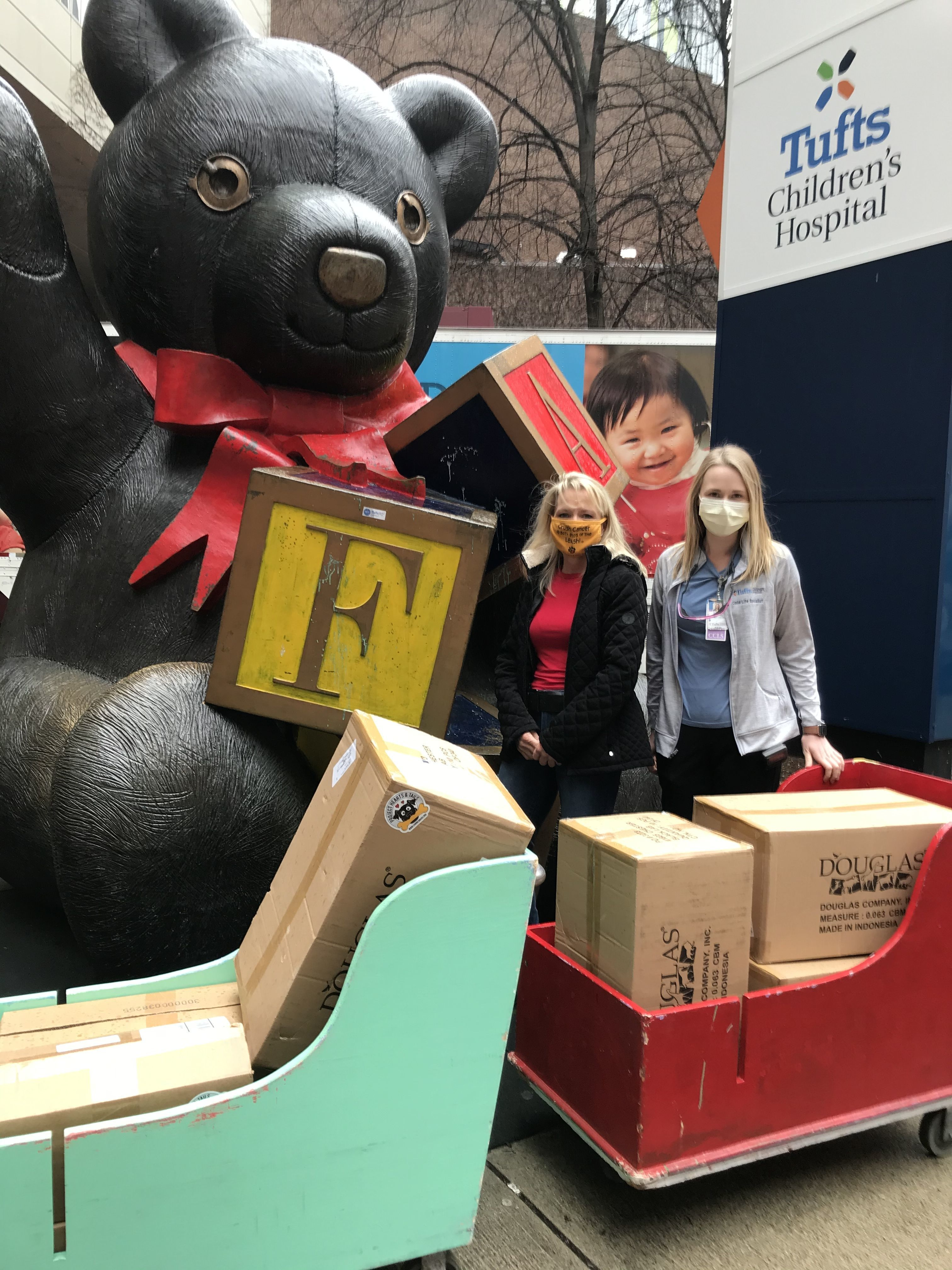 Project Hearts & Tails pups & books arrive at Tufts Children's Jan 2021