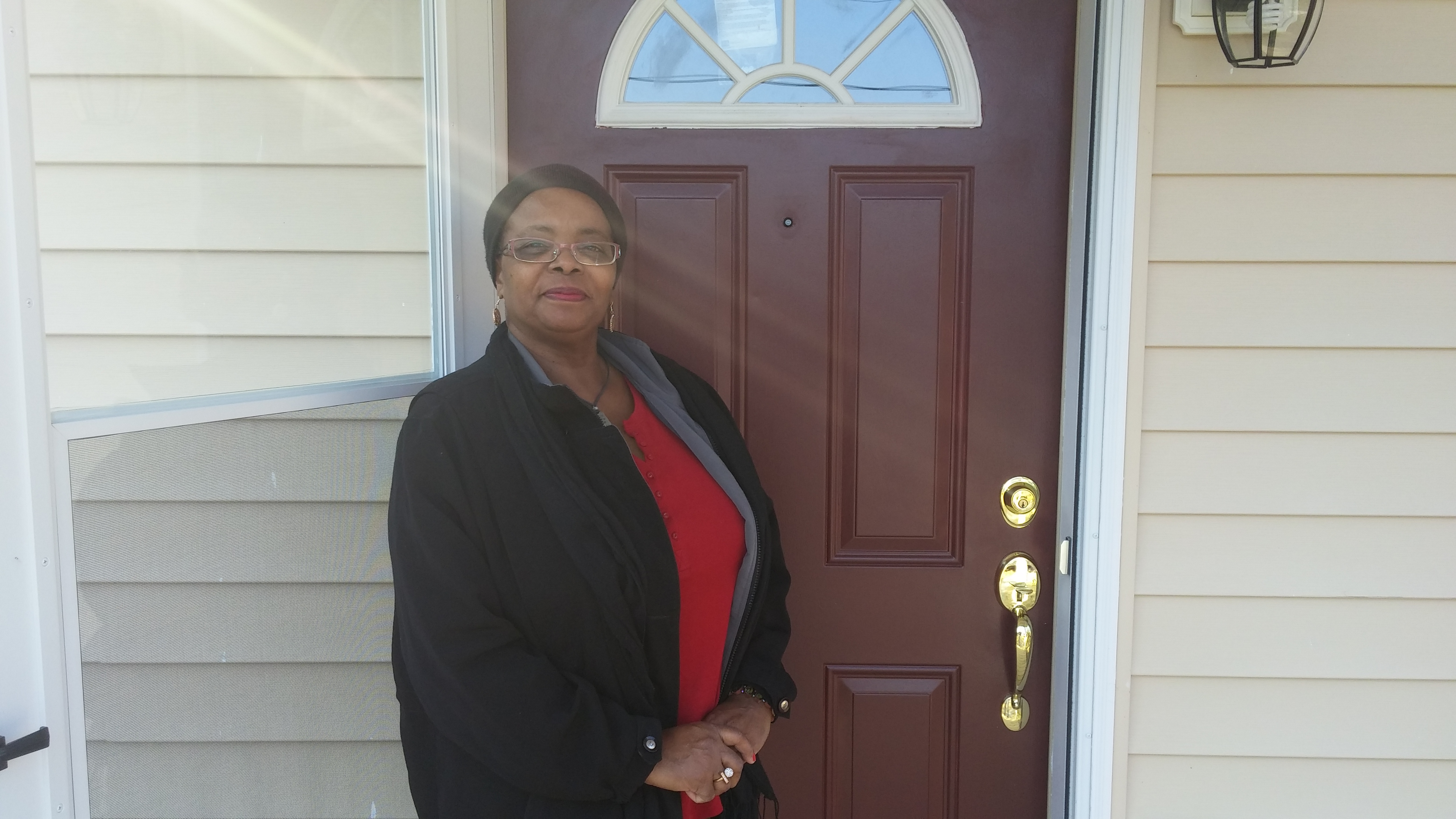 Lisa standing by new door