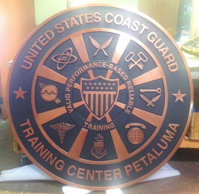 M7215  - Large2.5-D Multi-level Copper-plated Plaque of the Crest of the US Coast Guard Training Center in Petaluma.