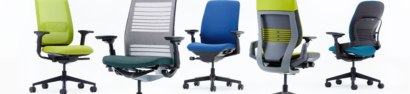 Five Chairs of Various Design and Color
