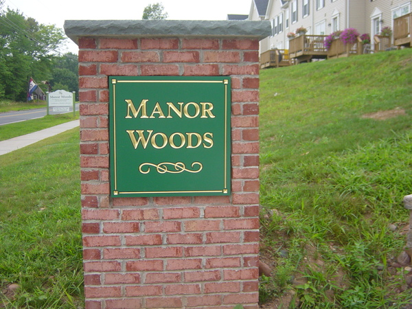 Carved Wall Sign Mounted to Brick Entrance Sign Pillar, 23k Gold Leaf Lettering and Border