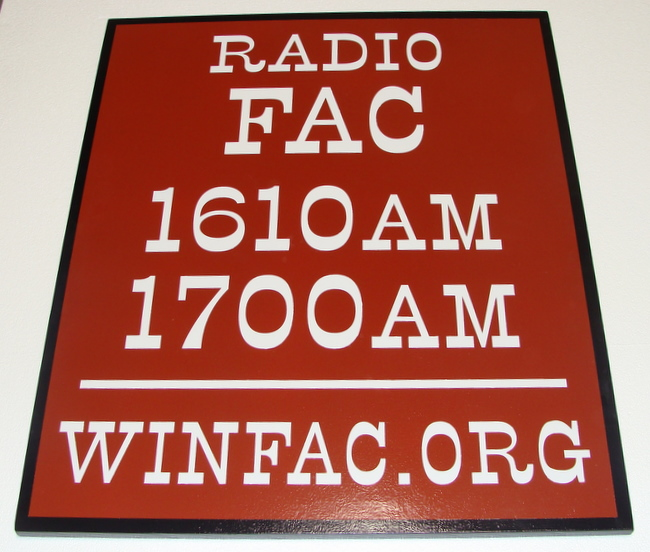 SA28588 - Sign for Radio Station with Radio Frequencies and Website Address