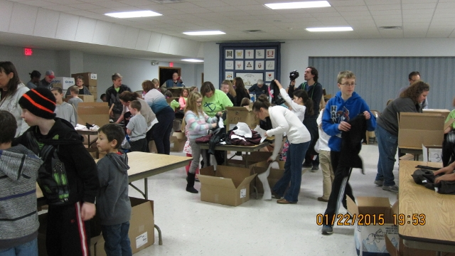 Students help pack clothes