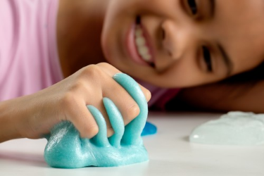 girl playing with slime