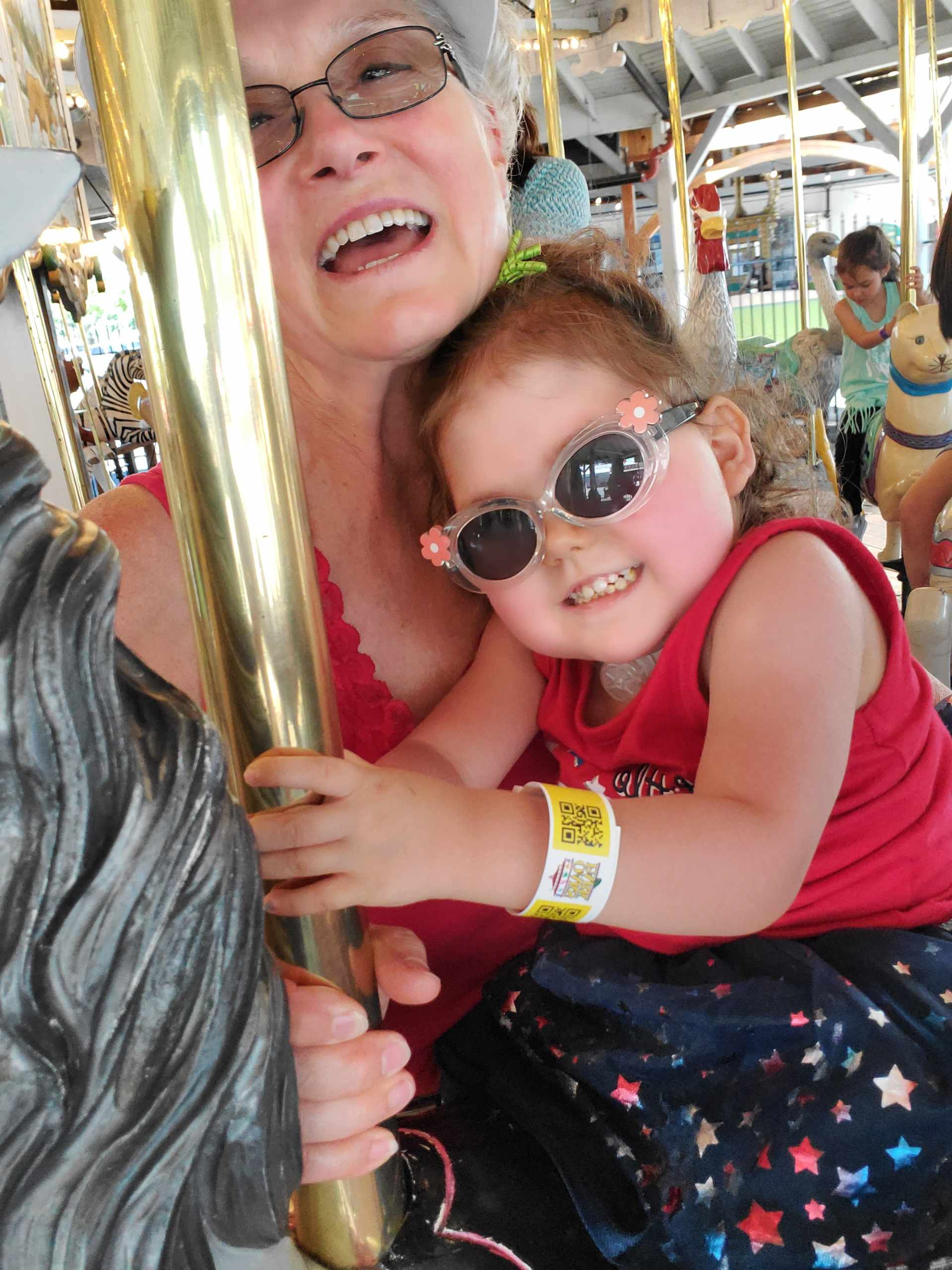 Nurse Mae and Saylor on the Merry-Go-Round