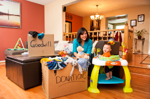 Mom and baby fill up Goodwill donation boxes