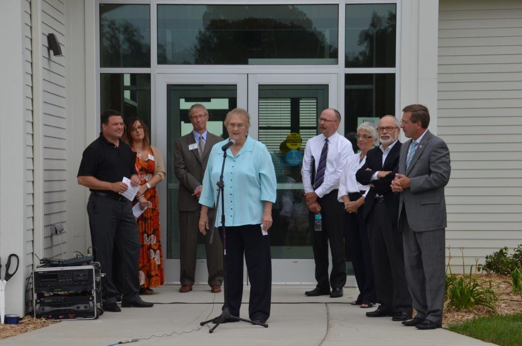 Judy Jasper speaks at the ribbon cutting