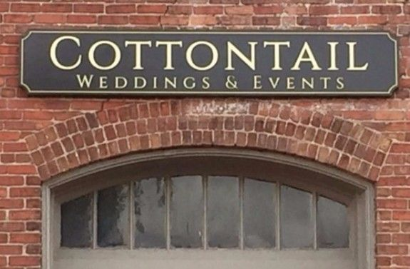M5004 - Carved 2.5-D HDU Sign for Cottontail Weddings & Events, Mounted on Brick Wall