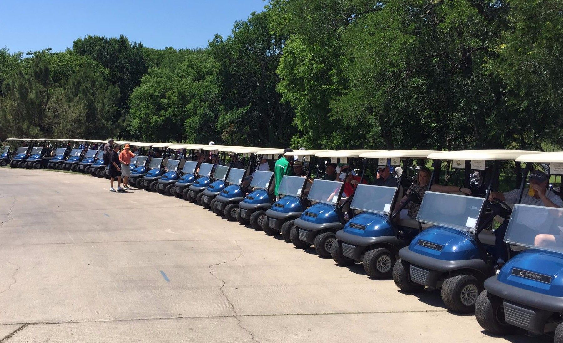 Golf carts lined up for a DHS Cares golf tournament