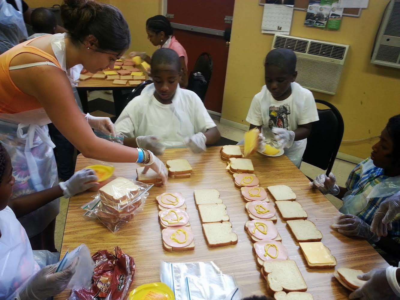 Making sandwiches for a local soup kitchen