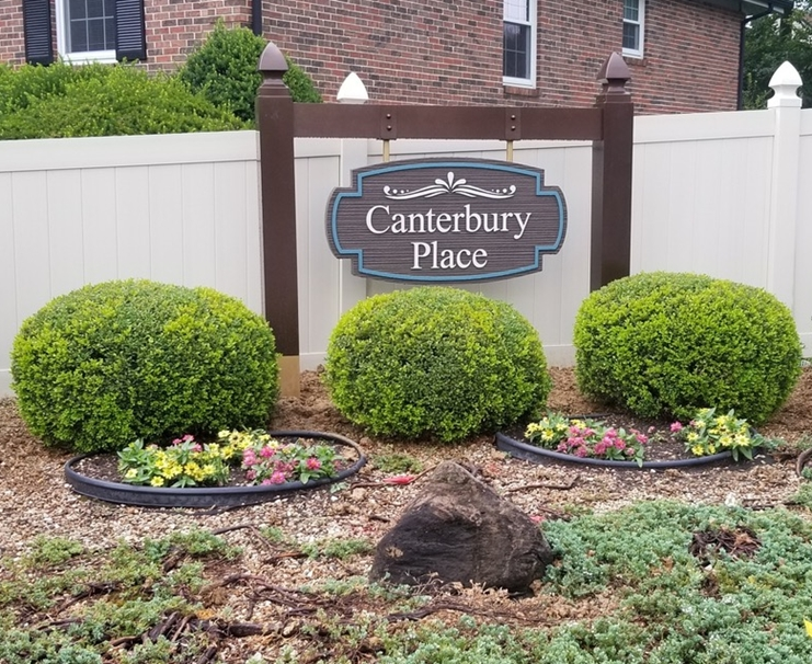"""I18102  -  Carved and Sandblasted High-Density-Urethane (HDU)  Sign for """"Canterbury Place"""", Hung from Overhead Wood Beam Supported by Two Wood Posts"""""""