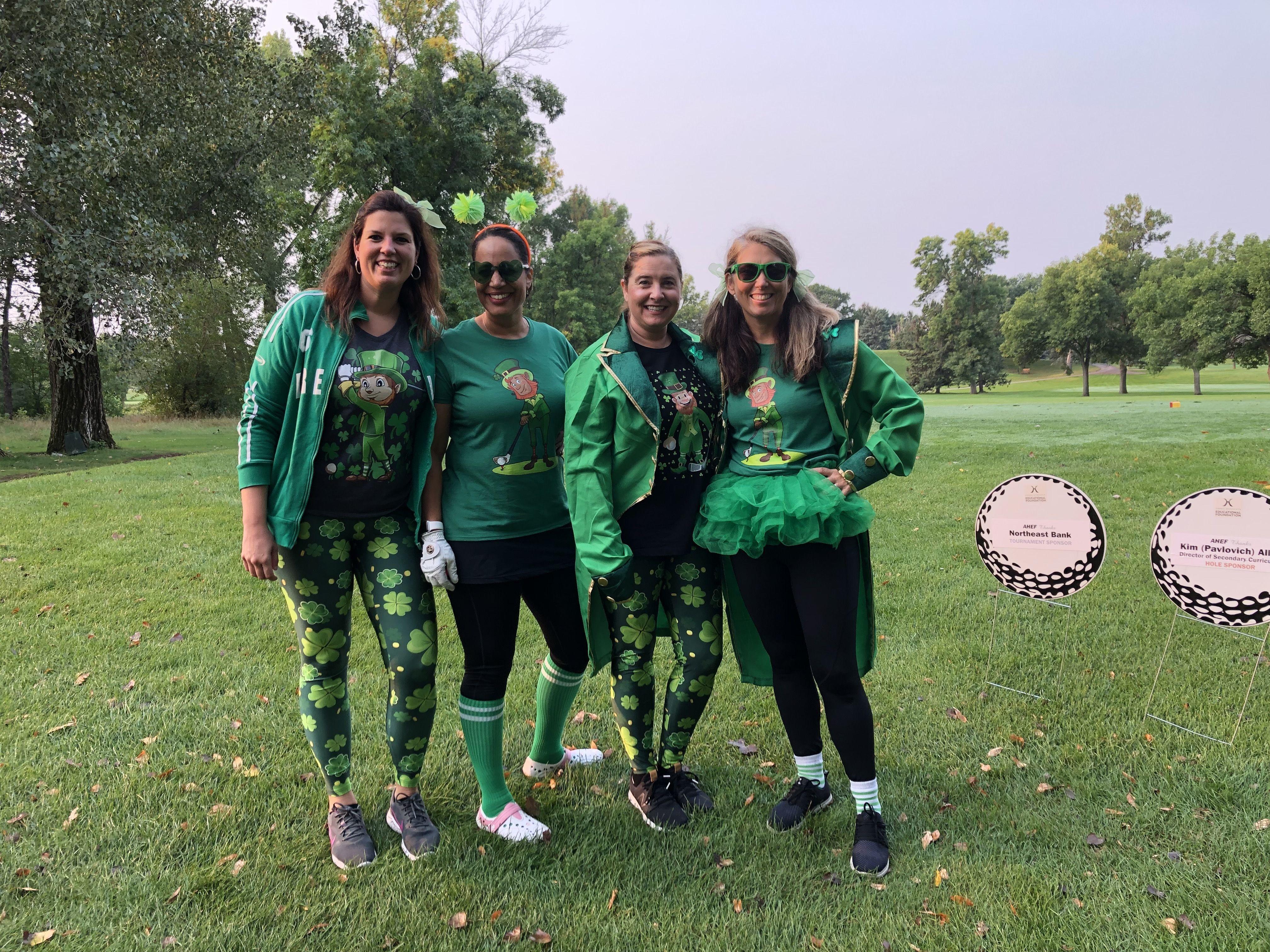 Photo of Team Tamura dressed in Irish costumes with Irish shirts, shamrock leggings, top coats, and tutus.
