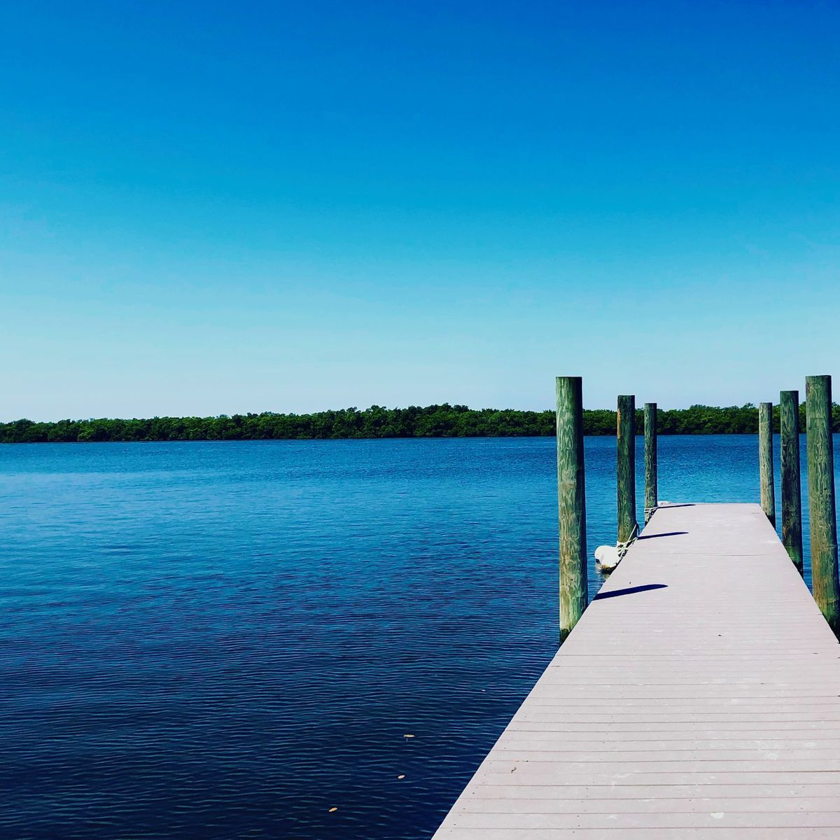 Long dock out over the blue water.