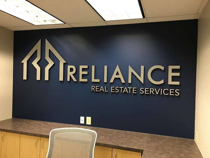 Office signs corporate signage office wall signage buena for Real estate office wall decor