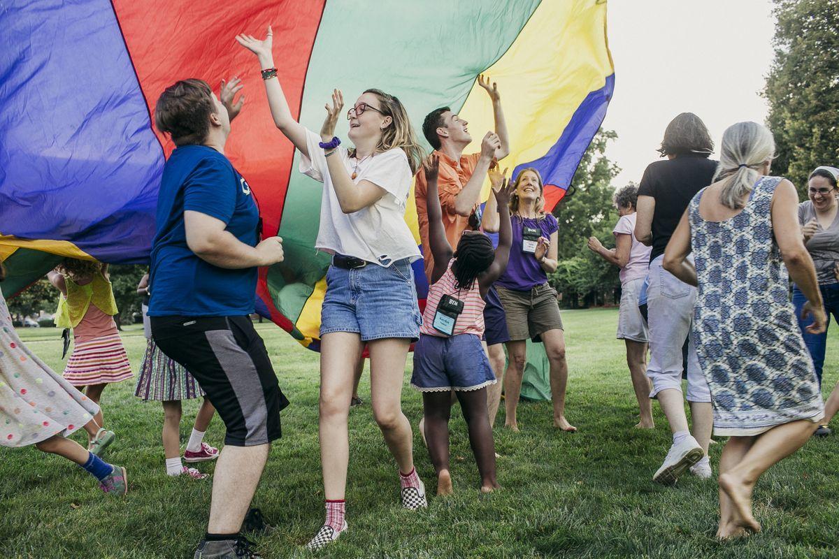 YFs and JYFs running under a rainbow parachute