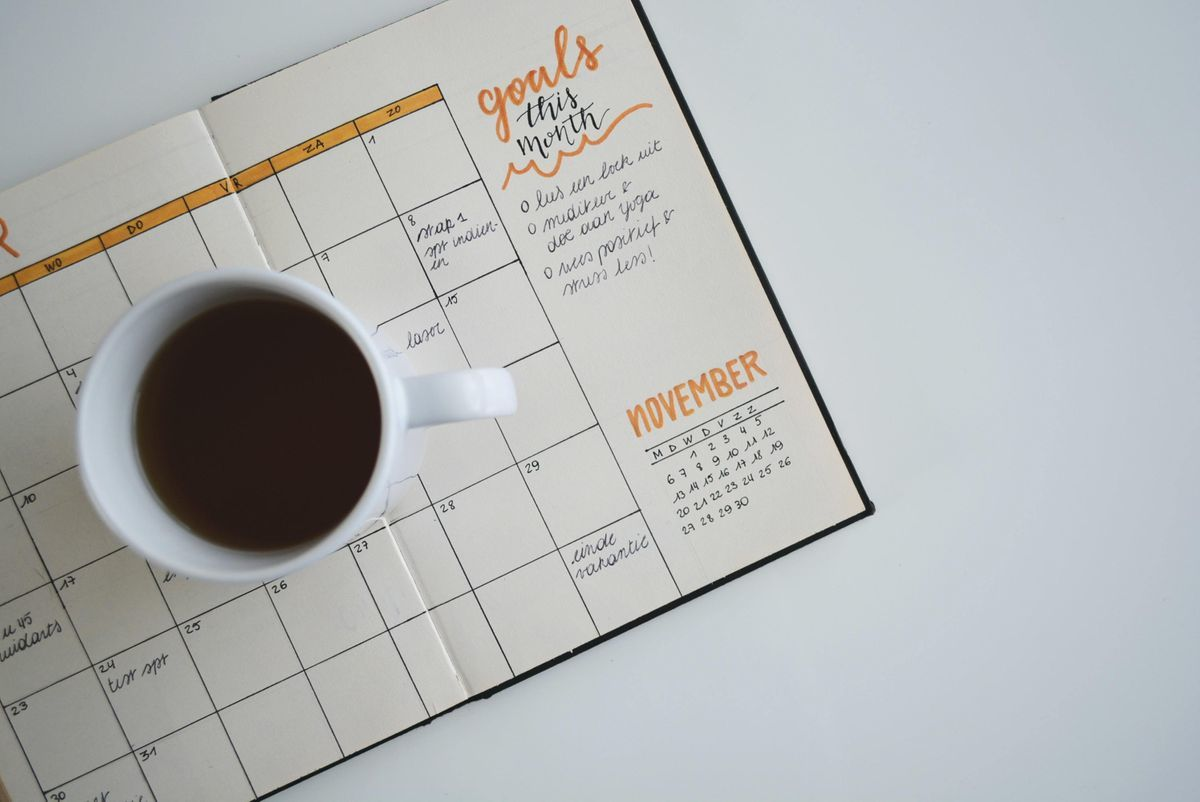 Monthly Planner with Cup of Coffee