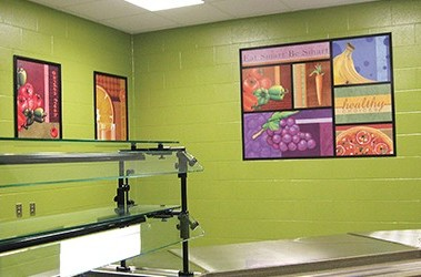 School serving line with illustrated food designs, custom signs, encourage healthy eating in students