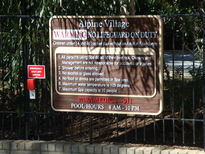 GB16310 - Carved, HDU Sign for Condominium Pool Rules (Shown in GB16754) Mounted on Fence