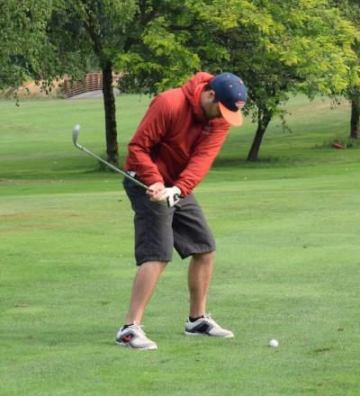 Sean looks at ball as he swings