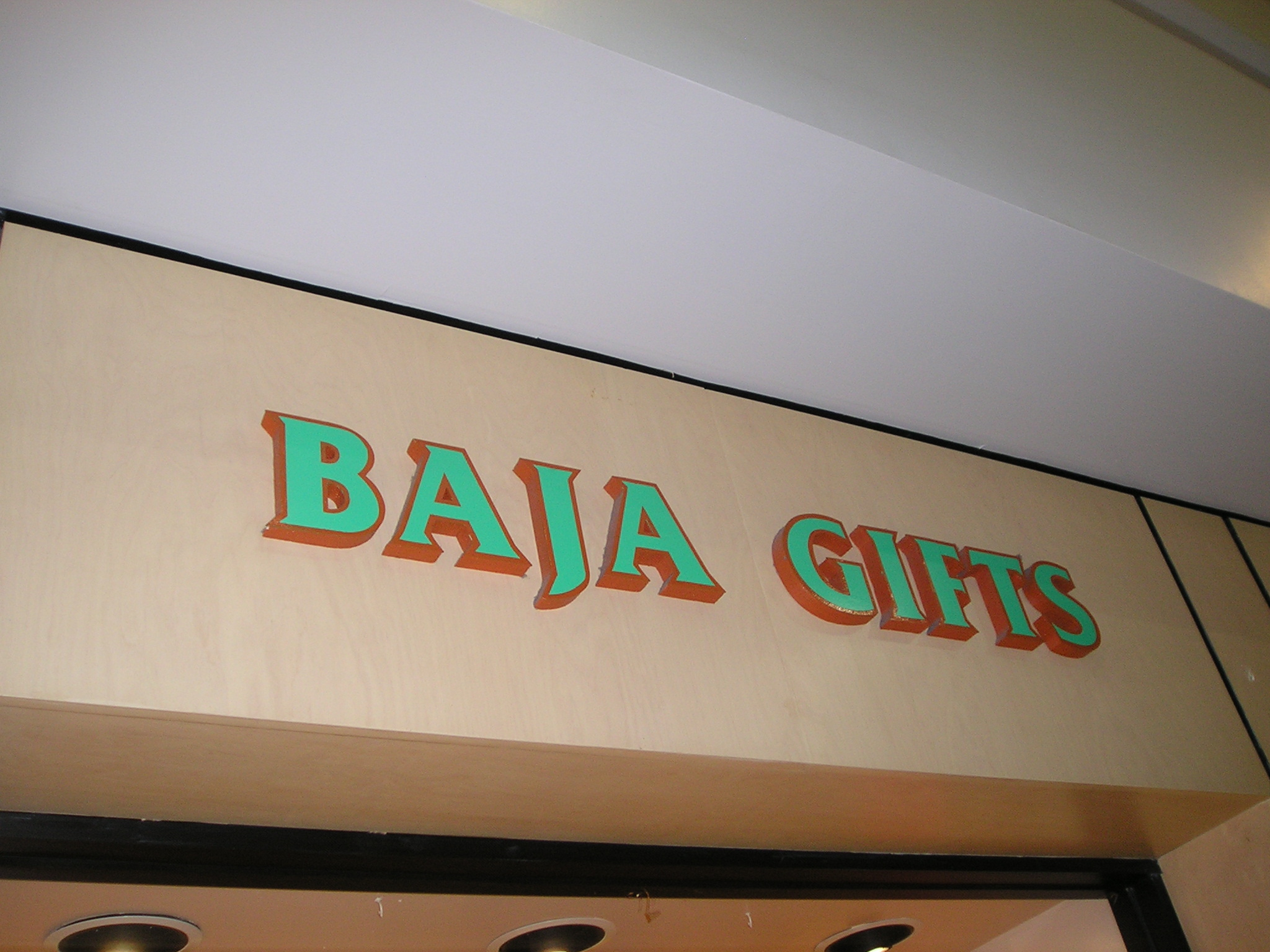 SA28343 - Shopping Mall Gift Shop Sign with Carved Raised Outline Letters.