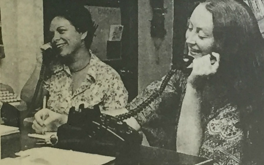 Volunteers Deb Marquette and Doris Payne answer phone calls on the information and crisis line.
