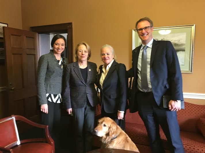 A photo of Krista Vasi, Moira Shea with guide dog Finnegan, and Mark Dunning with Congresswoman Niki Tsongas