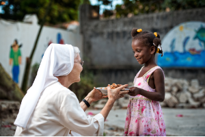Felician Mission in Haiti Sr. Marilyn with Child