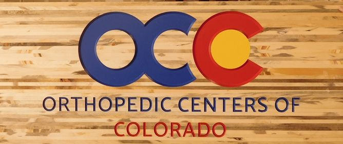 B11072 - Carved, Woodgrain Pattern, HDU Sign with Logo for Colorado Orthopedic Center