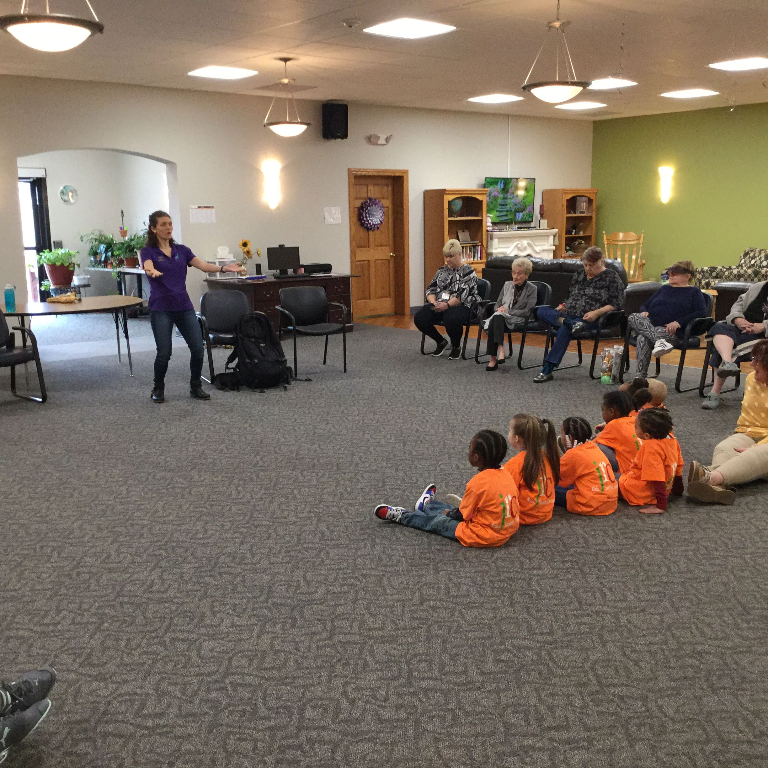 Lindsay Bonilla, Storyteller and Author describes the Intergenerational Connections Program of Storytelling for the day as she chooses her actors from both the children and senior/members.  The balance of the group will be asked to actively participate.