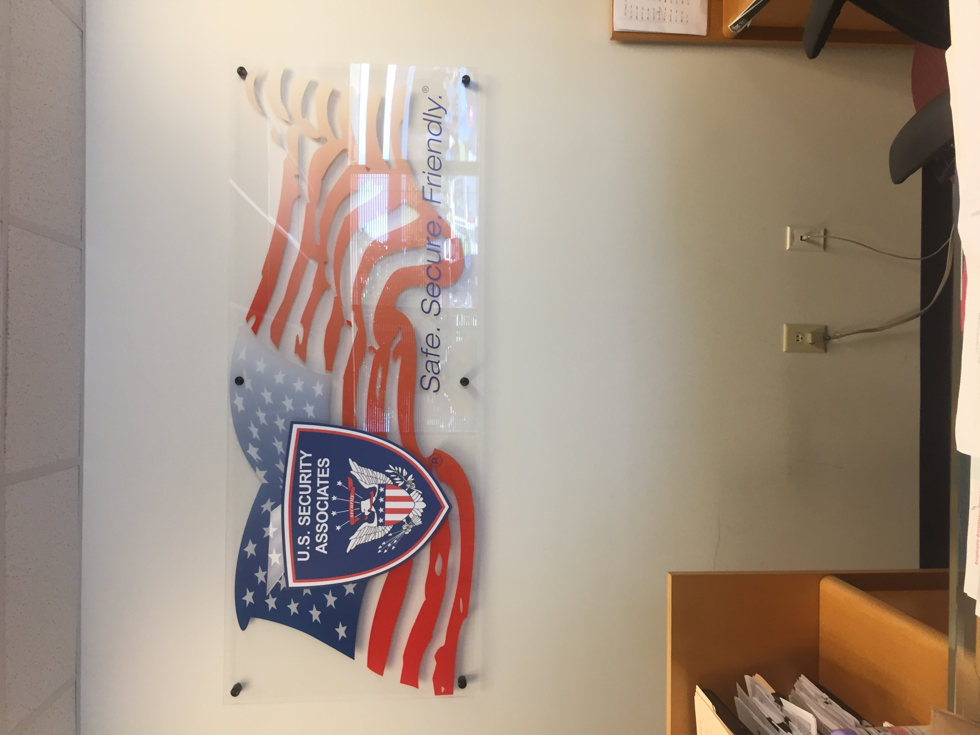Acrylic lobby sign with stand-off hardware