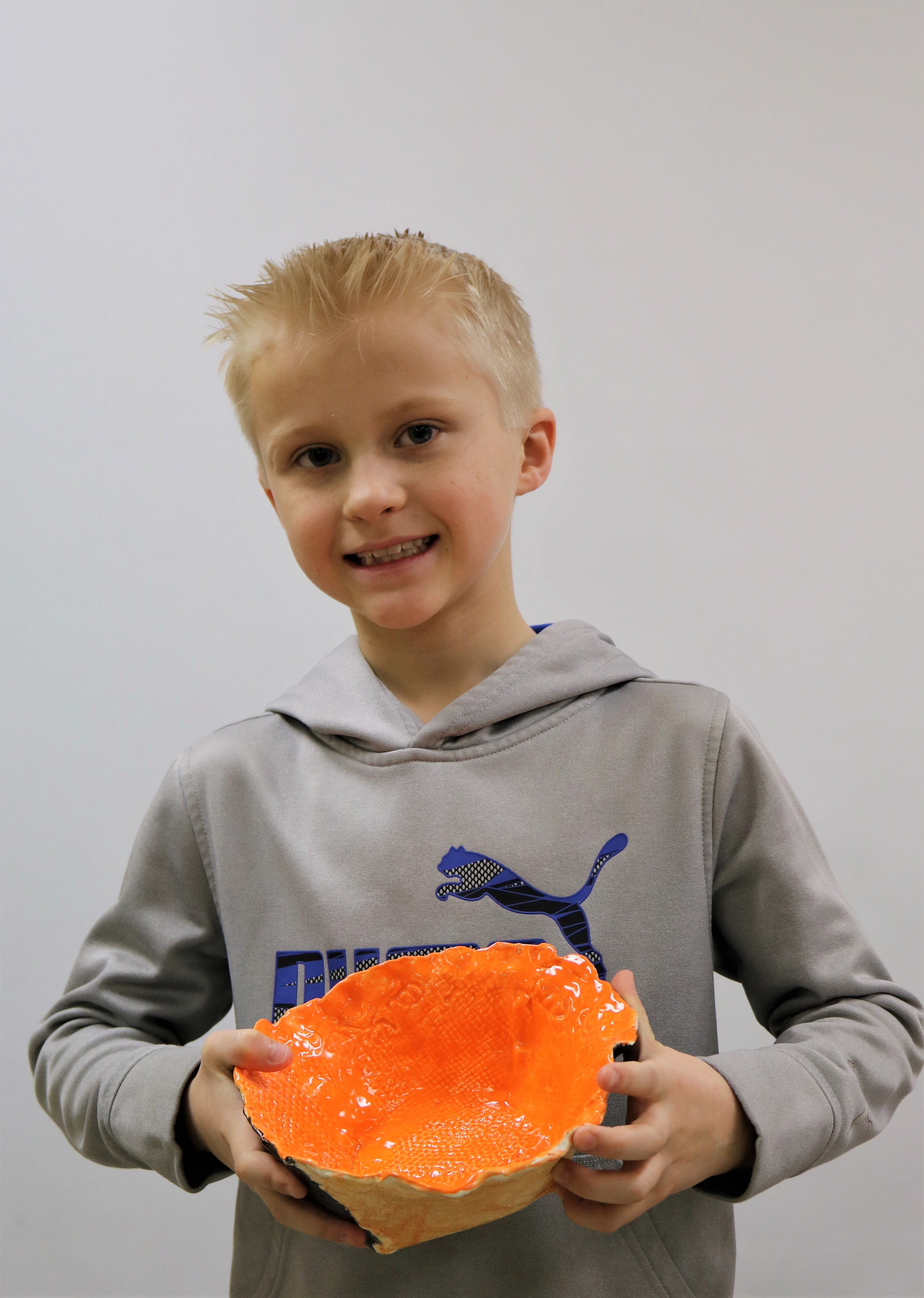 Ben Norby with one of the handmade bowls created for the Empty Bowls event at Lanesboro School