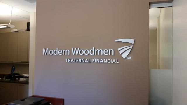 modern woodmen fraternal financial invests in brushed metal