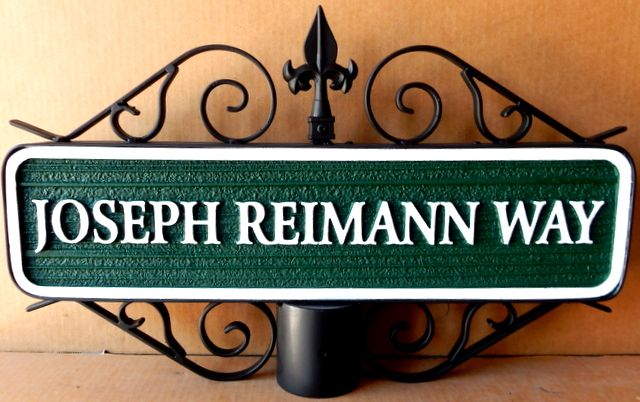M17064- Carved HDU Street Name Sign, Joseph Riemann Way, mounted on Post with Ornate Scroll Bracket