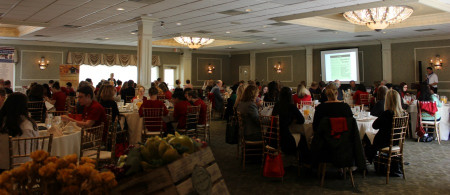 Executive Director, Ifeoma Aduba, speaks at the annual A Woman's Place appreciation breakfast.