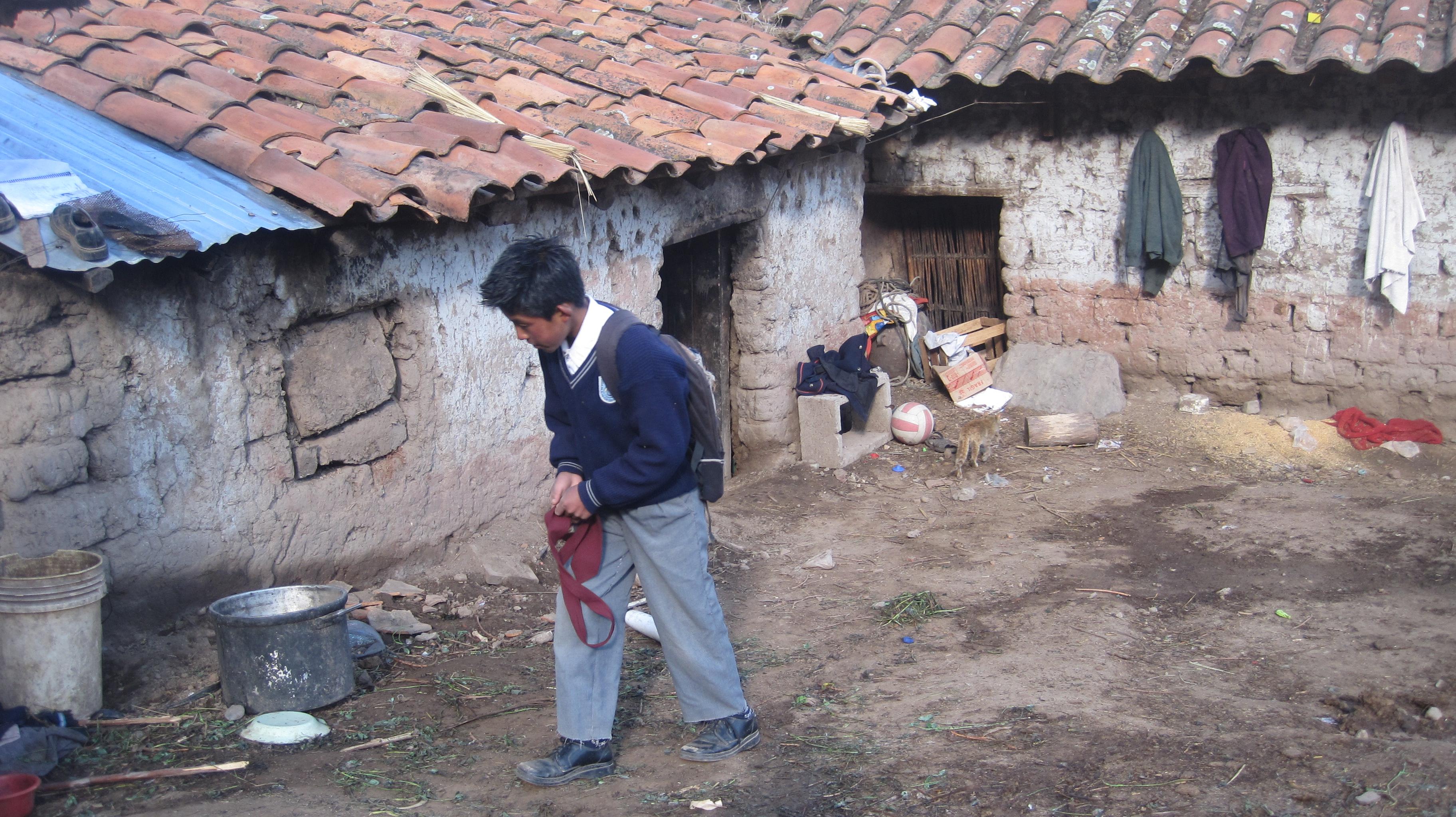 "Student of ""San José Obrero"" School in front of his home (Pomacanchi, Peru)"