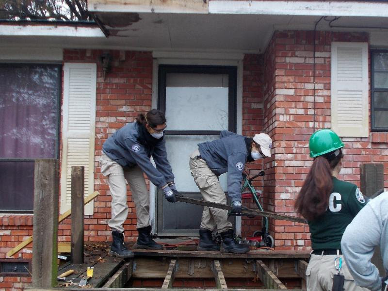 AmericaCorps Volunteers Make Progress on a Porch and Wheelchair Ramp