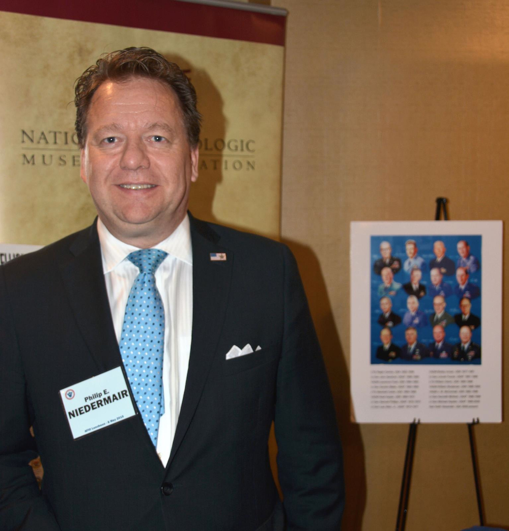 Visiting the NCMF booth at the 2015 AFIO Spring Luncheon