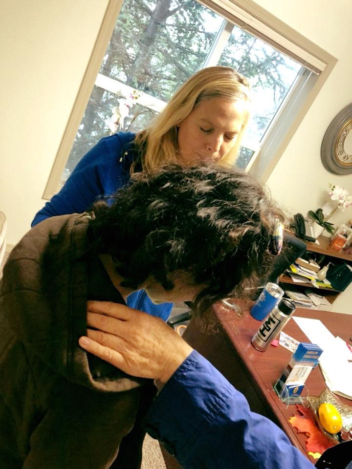 Praying over a client as she takes a big step along her healing journey and heads to rehab