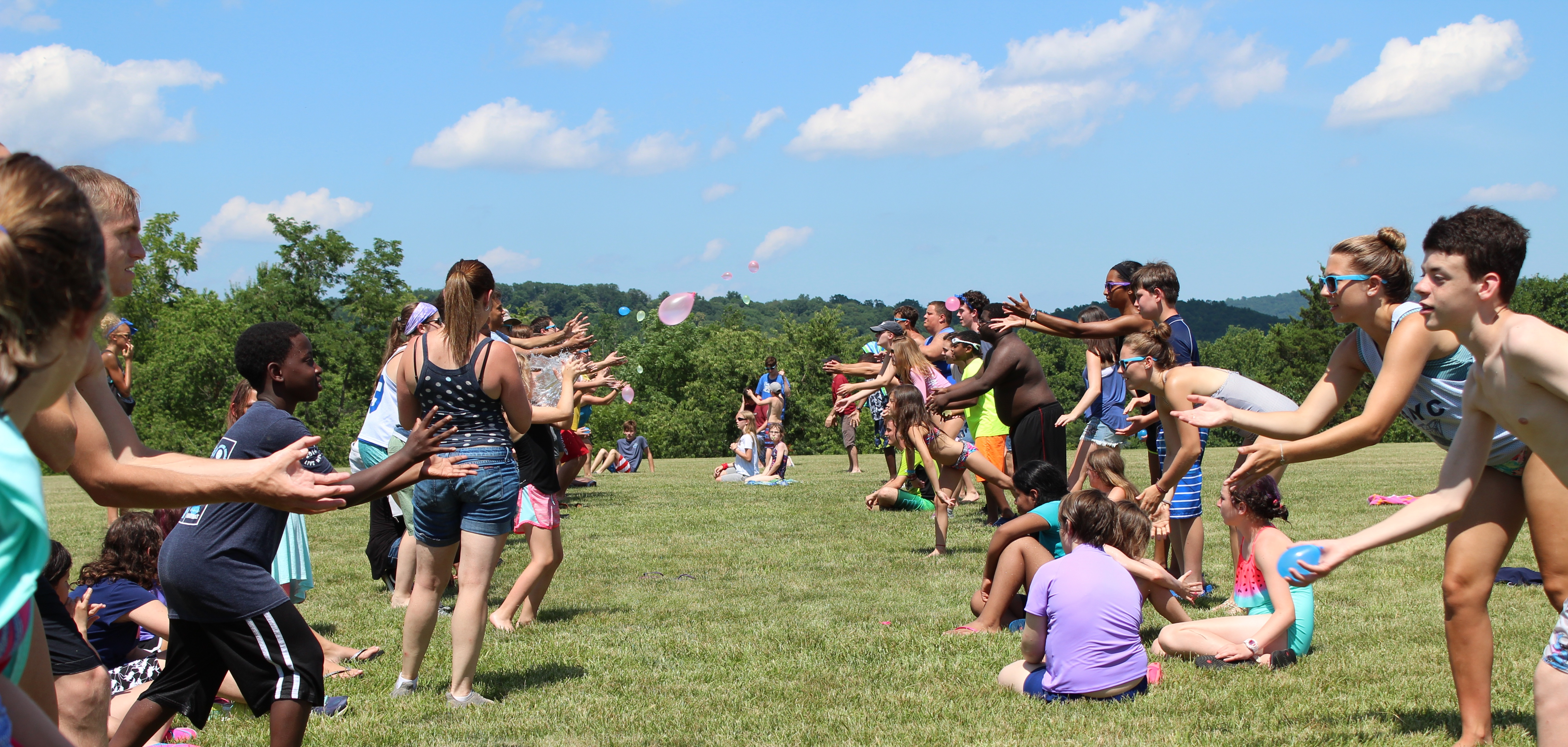 Campers play a balloon toss.