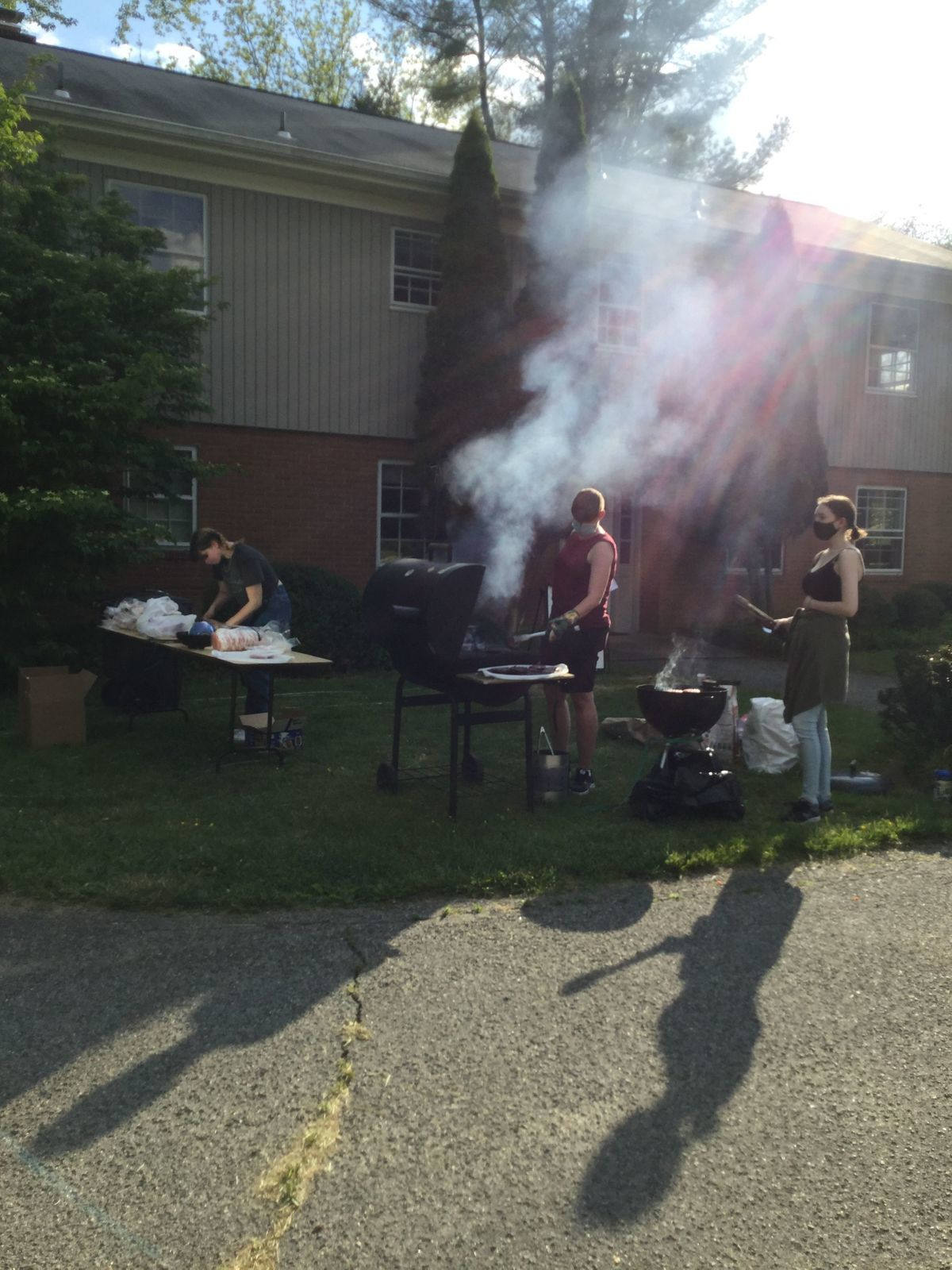 3 YFs prepare dinner over a grill