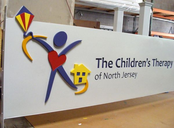 "FA15852 - Large Carved HDU Entrance Sign for  ""Children's Therapy"", 2.5-D Multi-level and Engraved  Raised Relief, with Stylized Child Logo as Artwork"