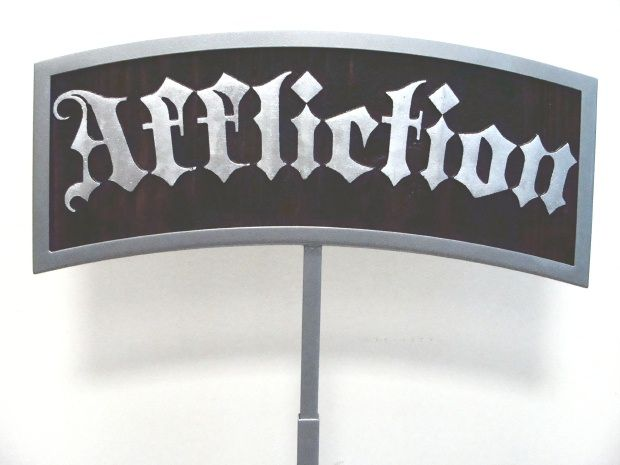 "SB28945 - Tabletop Point-of-Sale (POS) sign ""Affliction"" Made of Carved Stained Cedar wood and Cladded Aluminum, 2.5-D."
