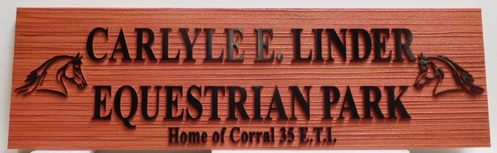 "P25633 - Carved and Sandblasted Wood Grain  Sign ""Carlyle E. Linder Equestrian Park"", with Two Horse Heads as Artwork"
