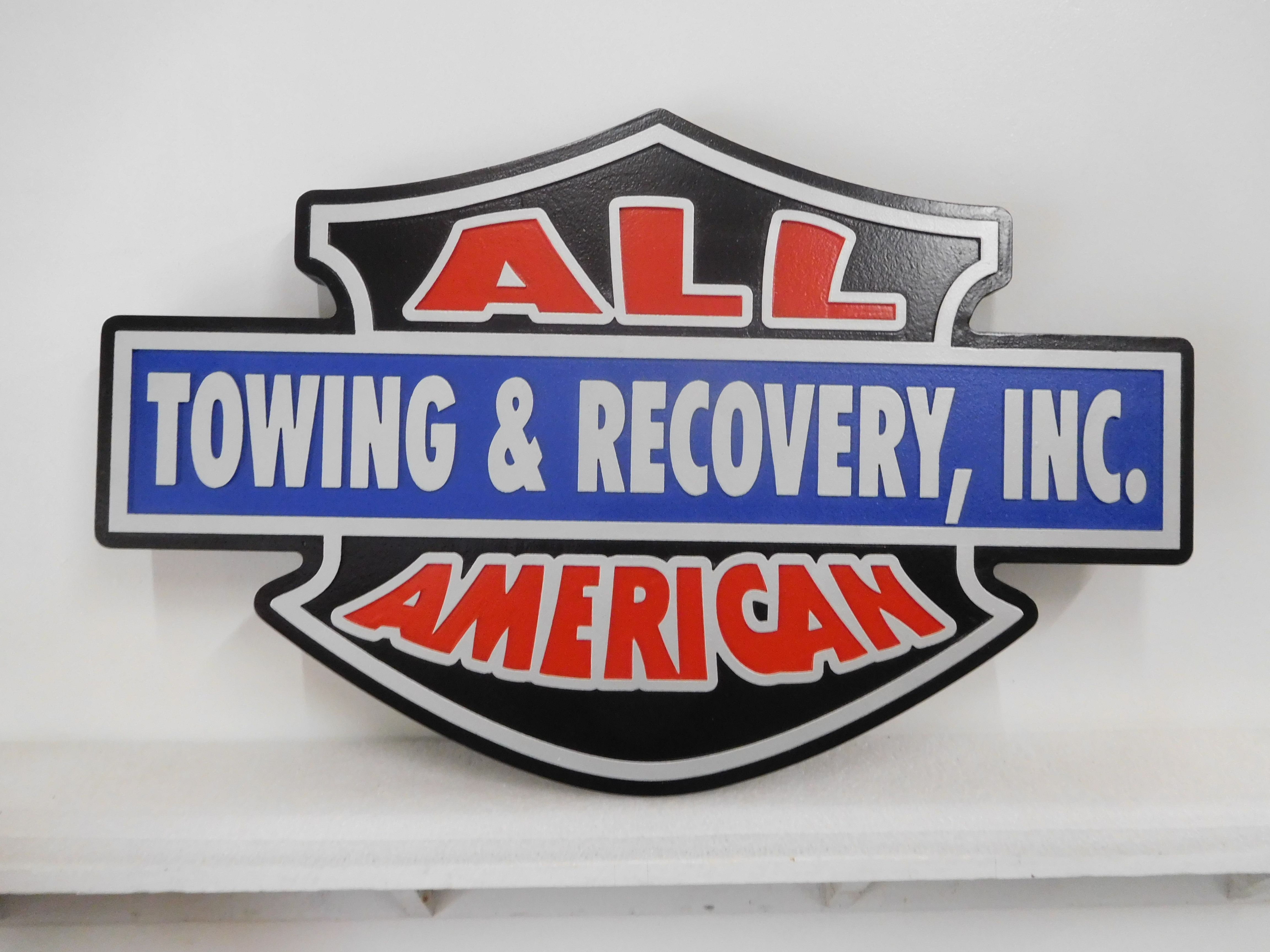 """S28102 - Colorful  and Attention-Getting  Carved Sign  for the """"All-American Towing & Recovery Company""""."""
