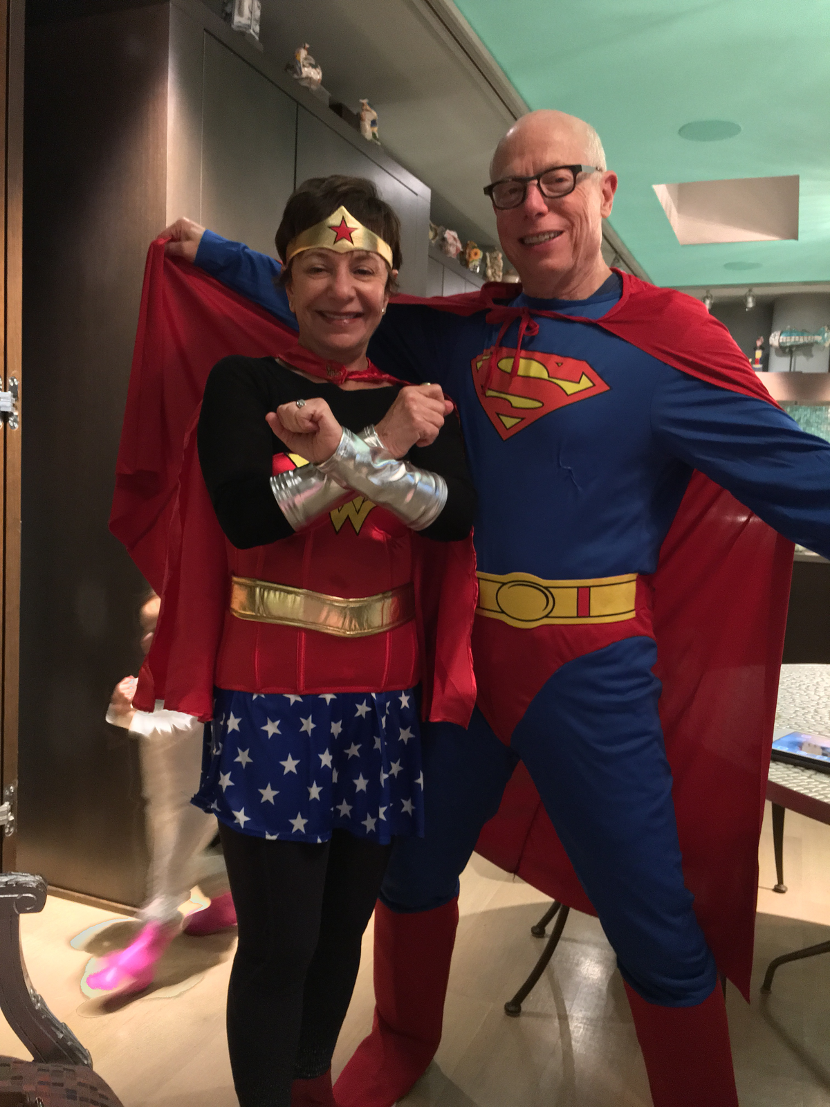 Michele and Stan Rosen as Wonder Woman and Superman during Purim.
