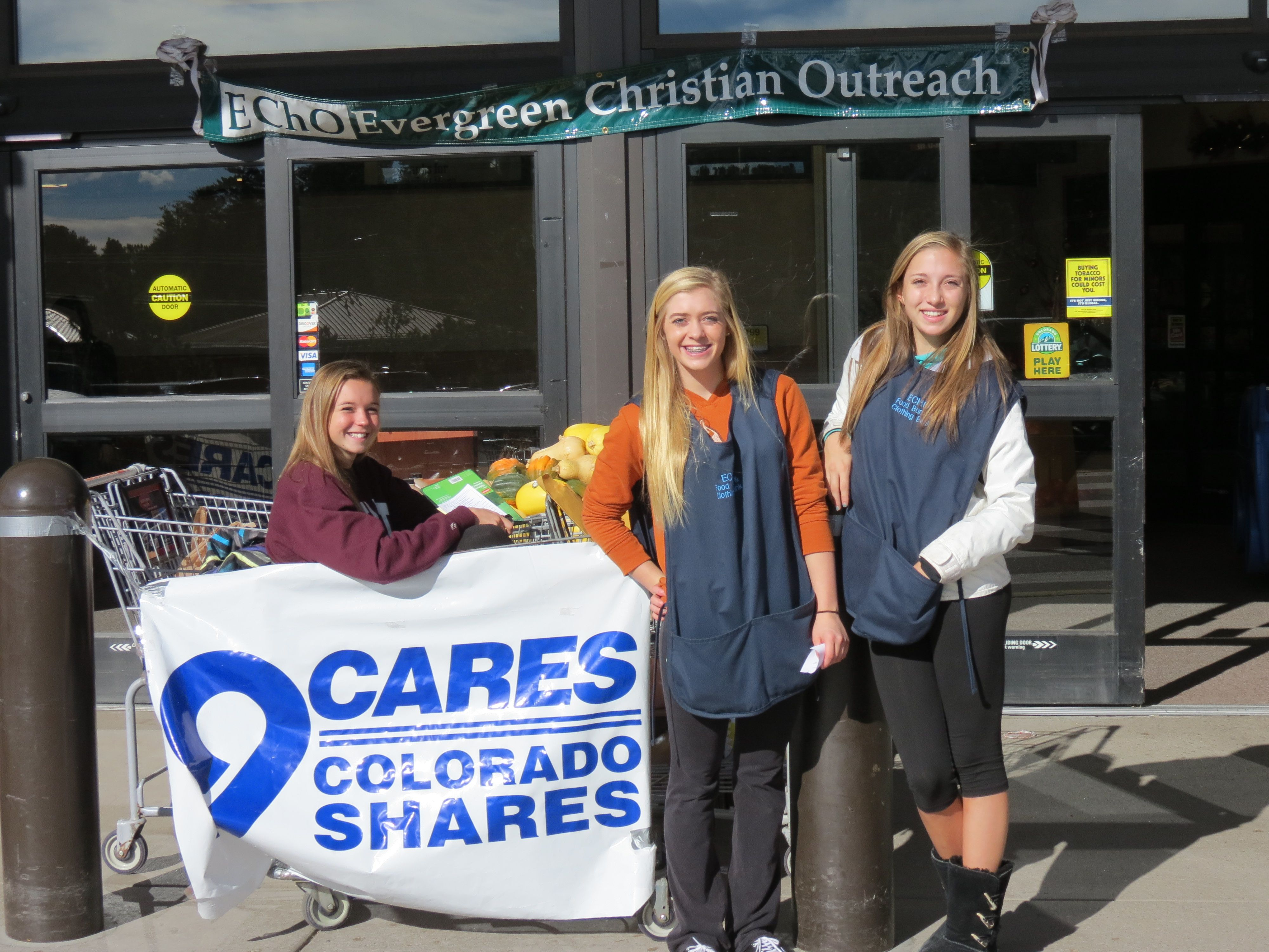 9 Cares Food Drive with three young volunteers